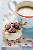 Meringue shell with raspberries and custard, with coffee