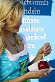 Girl with toffee apple (Oktoberfest, Munich)