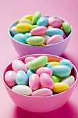 Coloured sugared almonds in two bowls