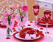 Valentine's Day table decoration of pink ranunculi & hearts