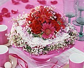 Romantic arrangement of roses, gerbera, gypsophila