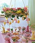 Wreath of tulips and narcissi hanging over Easter table
