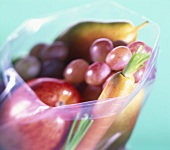 Apple, grapes, pear and carrots in freezer bag