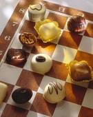 Assorted chocolates on a chess board