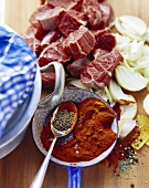 Ingredients for goulash: beef, paprika, onions, caraway