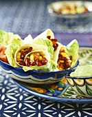 Tortillas with bean and sweetcorn filling, guacamole