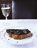 Bread topped with black truffles