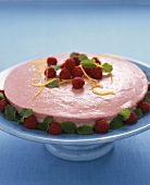 Raspberry mousse cake with lemon zest