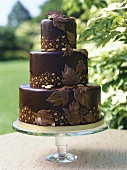 Three-tiered chocolate cake in the open air