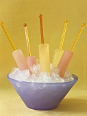 Ice lollies in a bowl of crushed ice