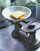 Two slices of hard cheese on old scales