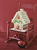 Gingerbread house on red child's chair
