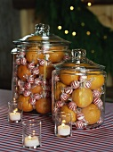 Oranges and mint sweets in jars for Christmas