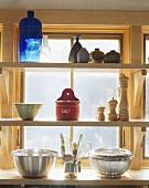 Kitchen utensils on shelves
