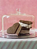 Ice cream sandwiches made with biscuits under glass cover