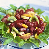 Fruit salad with strawberry leaves
