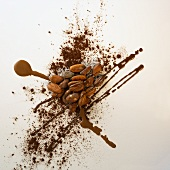 Almonds, cocoa powder and chocolate sauce