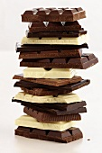 Pieces of white and dark chocolate, in a pile