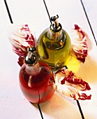 Still life with vinegar, oil and radicchio