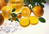 Orange juice with oranges and ice cubes