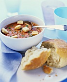 Cold cream of tomato soup with bread cubes