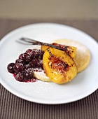 Baked peach with cherry compote and semolina biscuits