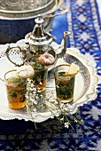 Arabic tea scene with herb tea, pastries and teapot