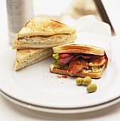 Club sandwich with chicken and sandwich with olive mayonnaise