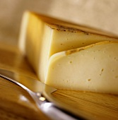 Raclette cheese with knife