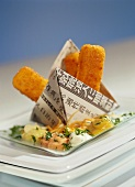 Fish fingers in Asian newspaper