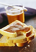 Slice of white bread with maple syrup