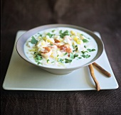 Coconut milk soup with shrimps and coriander leaves