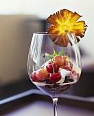 Cherry dessert with vanilla ice cream and blueberries