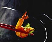 Shrimp tail on chopsticks