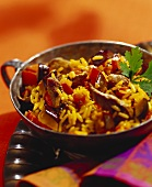 Lamb with curried rice in wok