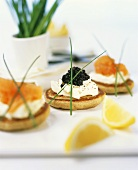 Blinis with sour cream, salmon and caviar