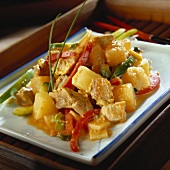 Sweet and sour pork with pineapple and strips of pepper