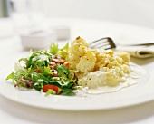 Fish fillet with creamed horseradish sauce & salad garnish