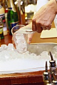 Filling glass with ice cubes