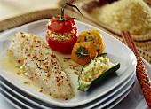 Grilled fish fillet with rice,  stuffed peppers and courgettes