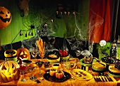 Table laid for Halloween with snacks