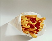 Chips with ketchup in paper bag