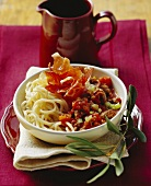 Pasta with meat ragout and dried ham