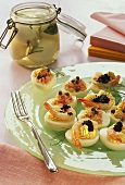 Eggs stuffed with shrimps & with ham & pickled eggs in jar