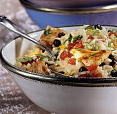 Middle Eastern chicken pilaw with vegetables and raisins