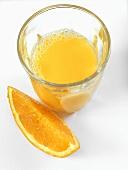 Orange juice and wedge of orange