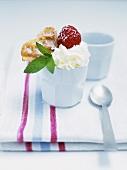 Sundae with heart-shaped waffle, strawberry and cream