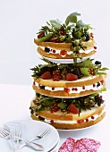 Three-tiered cake with berries