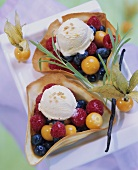 Fruit salad with vanilla ice cream in wafer shells