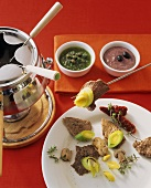 Lamb fondue with olive mayonnaise & parsley & caper sauce